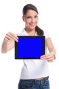Casual woman presenting a tablet young with both hands and smile isolated on white background Royalty Free Stock Photography