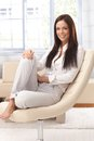 Casual woman relaxing at home Royalty Free Stock Photo