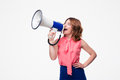 Casual woman screaming in loudspeaker Royalty Free Stock Photo