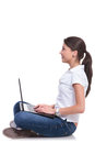 Casual woman sits with laptop Royalty Free Stock Photo