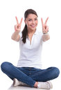 Casual woman sits & victory Royalty Free Stock Photo