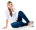 Casual woman sitting on the floor smiling isolated over a white background Stock Photography