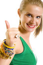 Casual woman smiling with her thumbs up Royalty Free Stock Photo