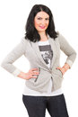 Casual woman smiling posing in gray jacket and jeans isolated on white background Stock Images