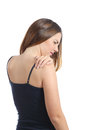 Casual woman suffering shoulder pain isolated on a white background Royalty Free Stock Images