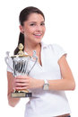 Casual woman with trophy young presenting a while smiling to the camera isolated on white background Stock Photography