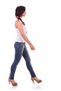 Casual woman walking to side view of a young ahead and looking away on white background Stock Images