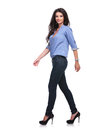 Casual woman walks away and looks at you Royalty Free Stock Photo