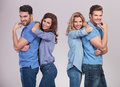 Casual women leaning on their men Royalty Free Stock Photo