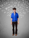Casual young man with abstract white media icon doodles on gradient background Royalty Free Stock Images
