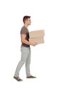 Casual young man carrying boxes isolated on a white background Stock Images