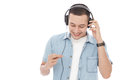 Casual young man enjoy music wearing headphones Royalty Free Stock Photo