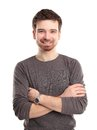 Casual young man looking at camera with arms crossed Royalty Free Stock Photo