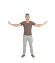 Casual young man looking up with arms extended isolated on a white background Royalty Free Stock Image