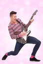 Casual young man playing a guitar Royalty Free Stock Photography