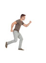 Casual young man running isolated on a white background Stock Image