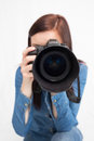 Casual young photographer taking picture of camera against white background Stock Photos