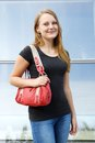 Casual young woman with handbag Royalty Free Stock Photo