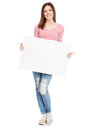 Casual young woman holding a white board Stock Images