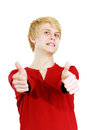 Casually dressed young man making a silly face and giving two thumbs up isolated on white Stock Photography