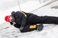 Casualty man is lying on a icy way and calling the ambulance street concept accident in winter season Stock Photography