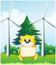 A cat holding an empty signboard in front of the windmills illustration Stock Photos