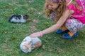Cat loves sweet little blonde girl