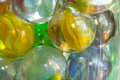 Cat s eye shooter marbles closeup of in glass mason jars Stock Photography