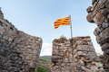 Catalan flag wavin waving over a ruined castle Royalty Free Stock Photos