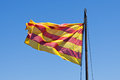 Catalan flag waving against blue sky Stock Images