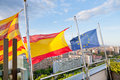 Catalan, Spanish, EU flags under Barcelona Royalty Free Stock Photos