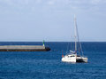 Catamaran anchored near jetty Royalty Free Stock Image