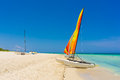 Catamaran with colorful sails on a tropical beach in cuba the white sands of varadero Royalty Free Stock Photos