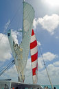 Catamaran sails white mainsail and red and white foresail on a taking cruise ship passengers to snorkeling sites in aruba Stock Photography