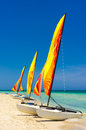 Catamarans at the beach of varadero in cuba three with their sails painted bright colors shore Royalty Free Stock Images