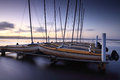 Catamarans moored at long jetty australia on tuggerah lakes after sundown exposure with lens filters Stock Photography