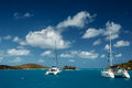 Catamarans in turquoise tropical waters in british virgin islands moored on a bright sunny day Royalty Free Stock Image