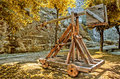 Catapult wooden medieval ballistic weapon Royalty Free Stock Photo