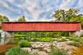 Cataract covered bridge over mill creek the falls crosses indiana s with a cloudy blue evening sky above Royalty Free Stock Images