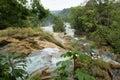 The cataratas de agua azul chiapas mexico water flows through jungle at Royalty Free Stock Photos