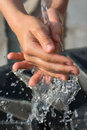 Catching Fresh and Cool Water with Hands Royalty Free Stock Photo