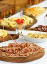 Catering assorted meats cheese and sausages olives spices Stock Photography