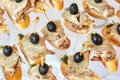 Catering of canape with olives, baguette and meat