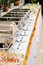 Catering wedding chafing dishes at table ready for Stock Photography