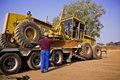 Caterpillar 140H Transporter - On Flatbed Trailer Royalty Free Stock Photo