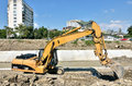 Caterpillar excavator on construction site forward activity the river bed Royalty Free Stock Images