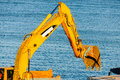 Caterpillar heavy machinery detail machine close up loading truck sea water background Stock Photo