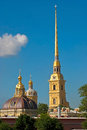 Cathedral bell tower and the dome spire of main of petropavlovskaya fortress background of blue sky Royalty Free Stock Image