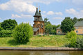 Cathedral with bell tower on volga river bank in russia wooden Royalty Free Stock Image
