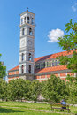 The cathedral of blessed mother teresa tower pristina kosovo july clock and belfry roman catholic view from park in Stock Photography